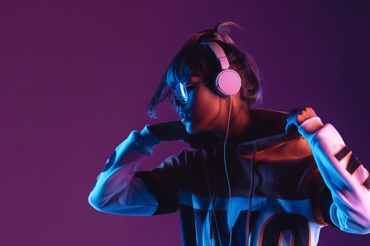 Cool young woman wearing headphones